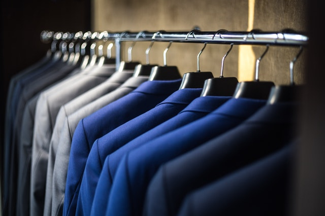 Rack of Blue grey and black suits