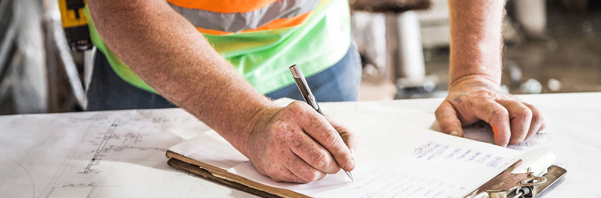 Worker signing a document