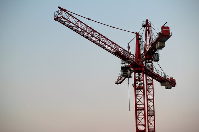Red crane against a sunset.